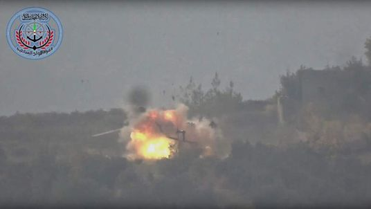 Syrian rebels have released a video claiming to show a helicopter being blown up in Syria