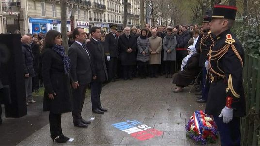 President Mitterand of France unveils plaque remembering Charlie Hebdo attack victims