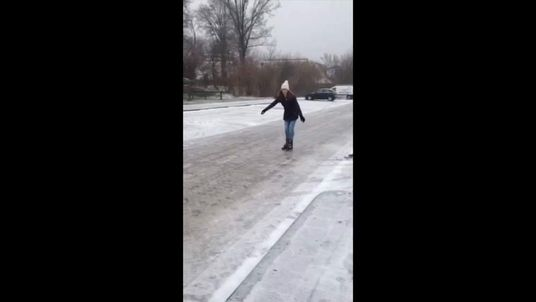 A woman skates down the road in Netherlands