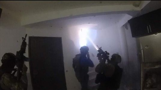 Mexican marines raiding a house seeking drug lord Joaquin Guzman