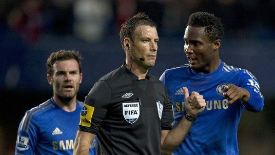 John Mikel Obi talking with referee Mark Clattenburg