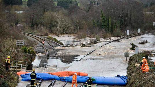 Railway engineers check inflatable dams on the railway line at Cowley Bridge