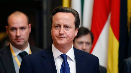 Britain's PM Cameron leaves a EU leaders summit at the EU Council in Brussels