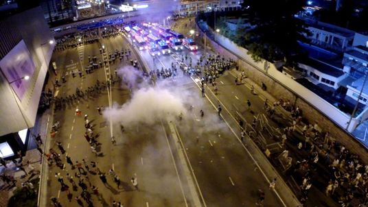 Drone captures Hong Kong police tear gas charge