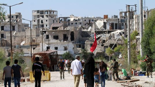 Syrians return to an area of Aleppo that was previously under rebel control