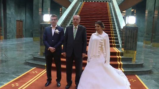 Turkey's president meets a newlywed couple at the presidential palace