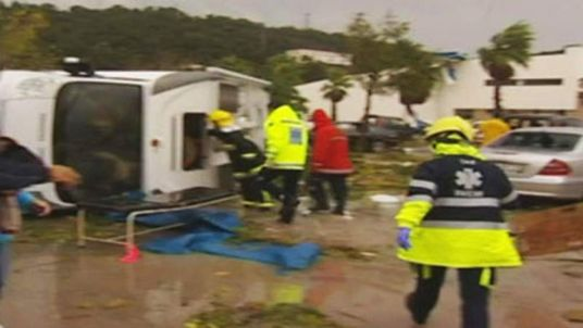 Emergency services tend to victims of a tornado in Portugal.