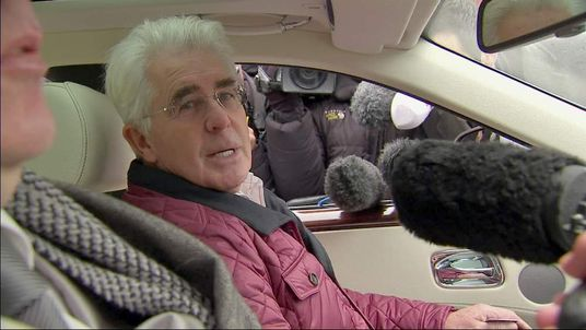 Publicity guru Max Clifford talks to press inside his car.