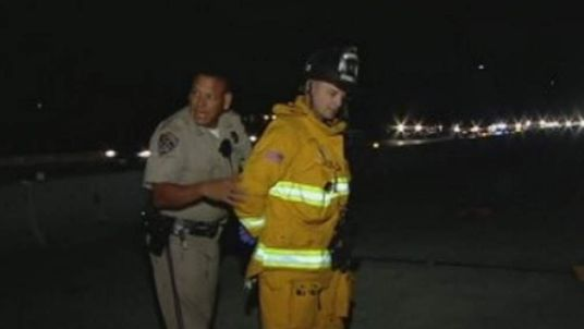 A California Highway Patrol officer handcuffed the firefighter. Pic: KFMB-TV