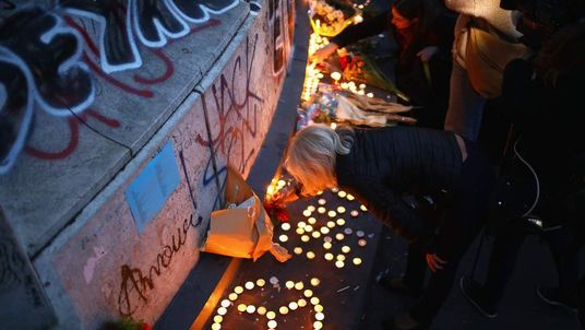 Parisians light candles the day after the deadly terror attacks of 13 November 2015.