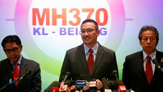 Malaysia's acting Transport Minister Hishammuddin Hussein addresses reporters about the missing Malaysia Airlines flight MH370, at Kuala Lumpur International Airport