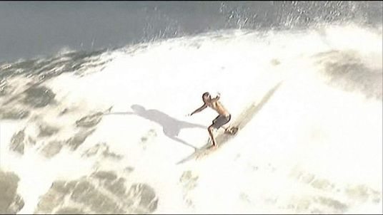 A bodysurfer riding a wave