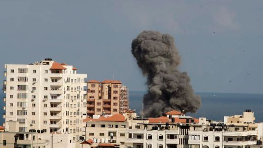 Smoke rises following what witnesses said was an Israeli air strike in Gaza City