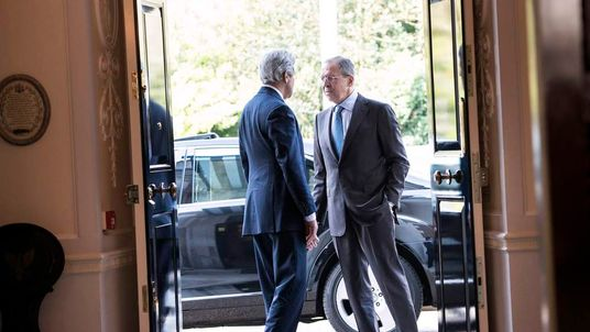 US Secretary of State John Kerry greets Russia's Foreign Minister Sergei Lavrov