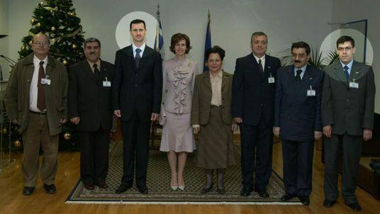 Khaled al Ayoubi (R) and Bashar Assad (3rd left)