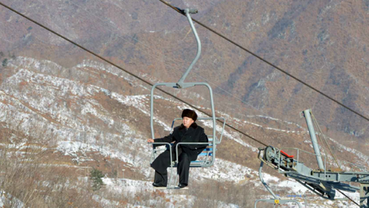 Kim Jong-Un on a ski-lift at Masik, North Korea's first.