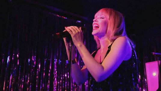 Kylie Minogue surprised revelers at an East London pub with a special gig.