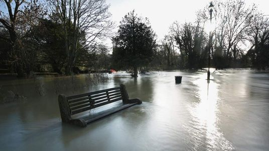Flood water from the River Mole rises after recent heavy rain in Leatherhead