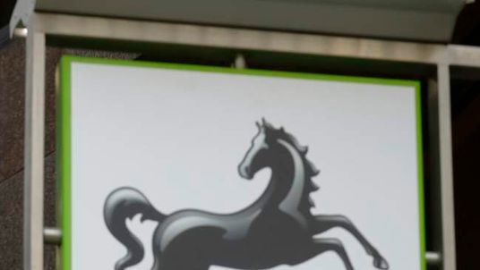 A sign is seen outside a branch of Lloyds Bank in central London