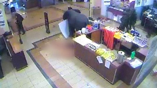 A Kenyan soldier appears to take a box from a shop at the Westgate centre