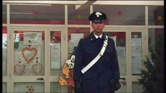 A policeman stands guard outside the nursery school