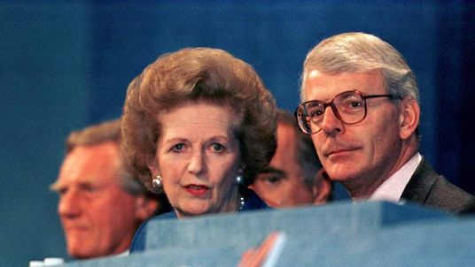 Baroness Thatcher accompanies Prime Minister John Major in 1995