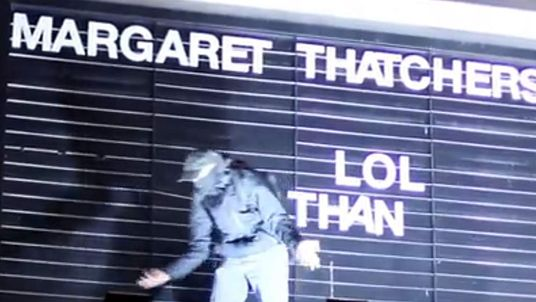 A reveller replaces letters on the Ritzy cinema in Brixton after Margaret Thatcher's death