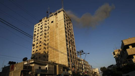 Smoke rises from media building targeted in air strike