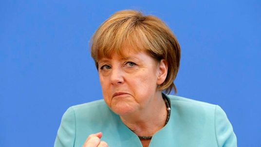 Merkel gestures as she address media during a news conference at Bundespressekonferenz in Berlin