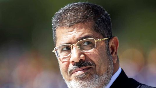 Egypt's President Mohamed Mursi reviews the troops in an official ceremony before a meeting with Brazil's President Dilma Rousseff at the Planalto Palace in Brasilia