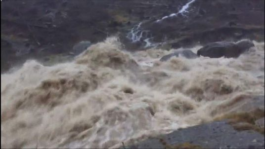 Footage of a small river raging after Storm Desmond rain in Cumbria
