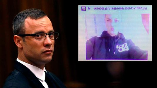 Olympic and Paralympic track star Oscar Pistorius sits in the dock ahead of his trial for the murder of his girlfriend Reeva Steenkamp, in Pretoria