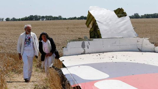 George and Angela Dyczynski walk near the wreckage of MH17