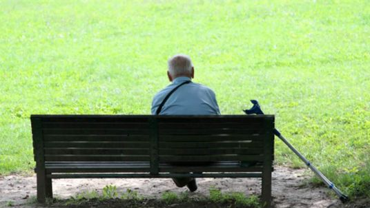 Pensioner sitting on a bench