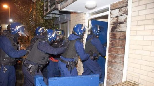 Police enter a premises in Lambeth, south London