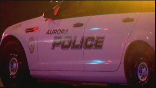 Aurora police car at the scene of a hostage-taking
