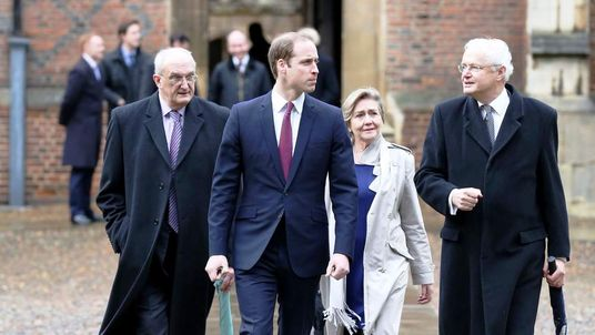 Prince William arrives at St John's College Cambridge, with officials from the university