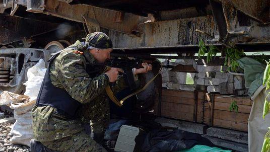 A pro Russian mans a checkpoint near Slavyansk