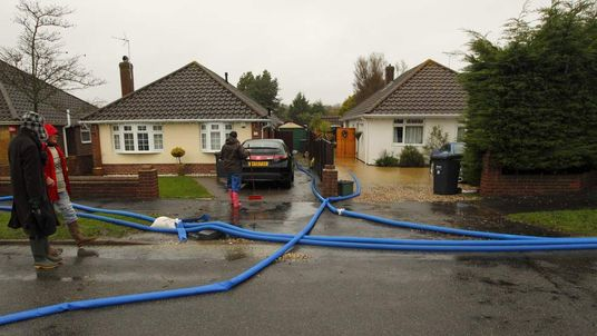 Residents pump rising flood waters from around their properties in Emsworth