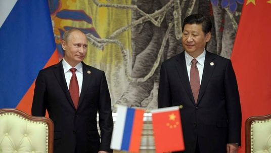 Russia's President Putin and China's President Xi Jinping attend a signing ceremony in Shanghai