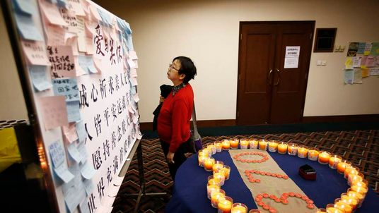 A Chinese woman whose husband was on board Malaysia Airlines MH370
