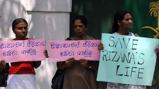 Sri Lankan women hold placards in protest at the planned execution of Rizana Nafeek