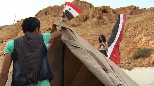 Pro-Assad camp set up next to Syria military base near Damascus