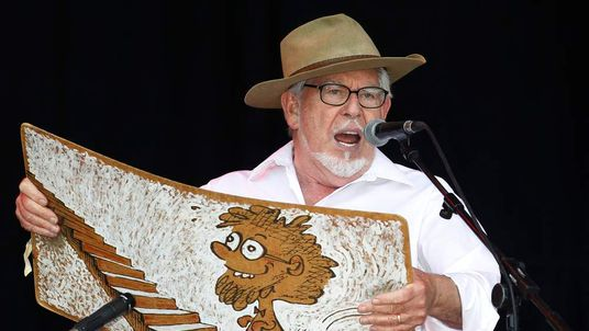 Australian singer Rolf Harris performs with his wobbleboard at the 2010 Glastonbury Festival