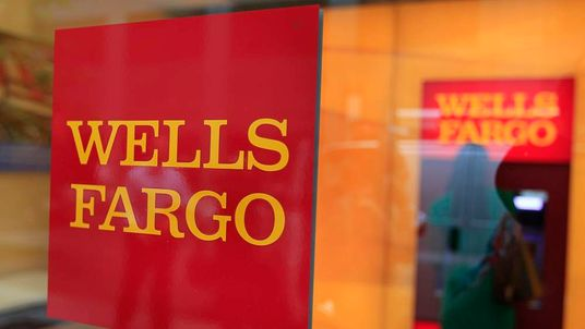 A Wells Fargo sign is seen outside a banking branch