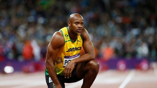 Jamaica's Asafa Powell looks at the scoreboard after running in the men's 100m final during the London 2012 Olympic Games at the Olympic Stadium