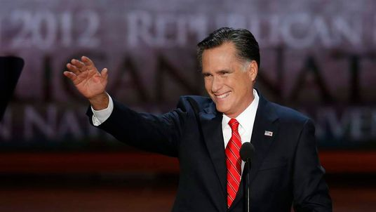 Mitt Romney waves as he begins acceptance speech