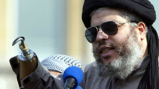 Muslim cleric, Abu Hamza al-Masri, is seen addressing the sixth annual rally for Islam in Trafalgar Square, London in this August 25, 2002.
