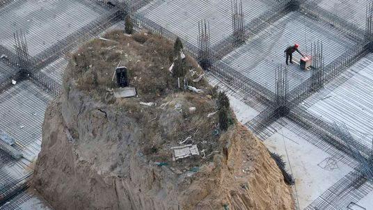 An ancestral tomb, measuring 10 metres high and a surface area of 10 square metres, is seen on the construction site of a building in Taiyuan, Shanxi province