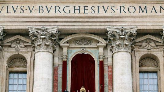 """Pope Benedict XVI arrives to bless the crowd as he makes his """"Urbi et Orbi"""" address from a balcony in St. Peter's Square in Vatican"""